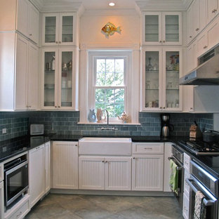 Inspiration for a small beach style u-shaped separate kitchen in Boston with a farmhouse sink, beaded inset cabinets, white cabinets, quartzite benchtops, blue splashback, glass tile splashback, ceramic floors and no island.