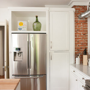 Kitchen - modern kitchen idea in Dallas with shaker cabinets, white cabinets and stainless steel appliances