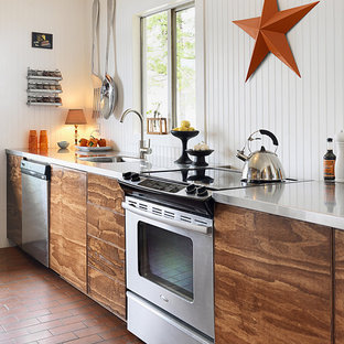 Design ideas for a beach style kitchen in Vancouver with stainless steel appliances and stainless steel benchtops.