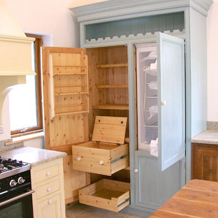 Inspiration for a classic kitchen pantry in Cork with blue cabinets and medium hardwood flooring.