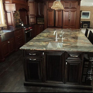 Inspiration for a large traditional l-shaped separate kitchen in Toronto with a farmhouse sink, raised-panel cabinets, dark wood cabinets, granite benchtops, multi-coloured splashback, matchstick tile splashback, panelled appliances, slate floors, with island, black floor and green benchtop.
