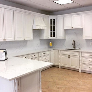 Large tropical eat-in kitchen pictures - Eat-in kitchen - large tropical u-shaped ceramic floor and beige floor eat-in kitchen idea in Boston with an undermount sink, open cabinets, white cabinets, quartz countertops, white backsplash, stone tile backsplash, stainless steel appliances, no island and white countertops