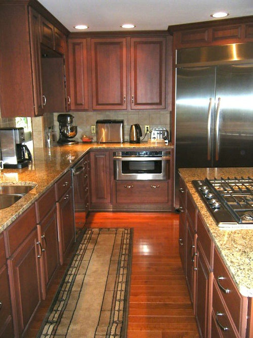 Galley Kitchen Design Ideas, Remodels & Photos with Dark Wood Cabinets ...