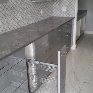 Inspiration for a mid-sized contemporary kitchen in Edmonton with flat-panel cabinets, grey cabinets, concrete benchtops, grey splashback, mosaic tile splashback and marble floors.