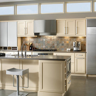 Small transitional open concept kitchen designs - Small transitional galley brown floor open concept kitchen photo in Orlando with shaker cabinets, white cabinets, brown backsplash, stone tile backsplash, stainless steel appliances, an island and quartzite countertops