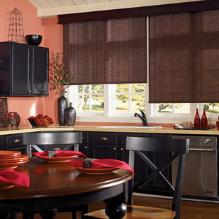 Inspiration for a mid-sized asian l-shaped eat-in kitchen in Burlington with a drop-in sink, shaker cabinets, black cabinets, tile benchtops, stainless steel appliances, medium hardwood floors and brown floor.