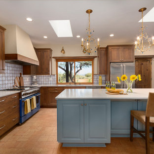 Large southwestern kitchen ideas - Inspiration for a large southwestern l-shaped brick floor kitchen remodel in Phoenix with an undermount sink, shaker cabinets, medium tone wood cabinets, quartz countertops, an island, white countertops, multicolored backsplash and colored appliances