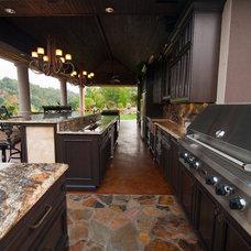 Mediterranean Porch by Kitchen Interiors, LLC