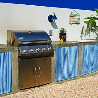 Outdoor kitchen with concrete counters & sunbrella panels