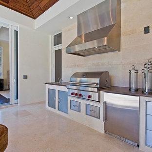 Tropical kitchen ideas - Island style kitchen photo in Miami