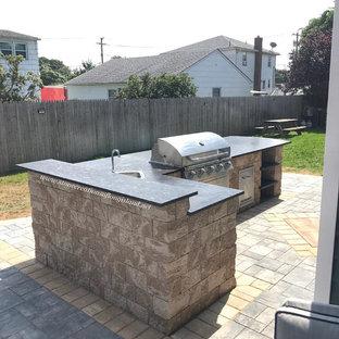 Idéer för ett stort modernt grå kök, med granitbänkskiva, rostfria vitvaror, tegelgolv, flera köksöar och blått golv