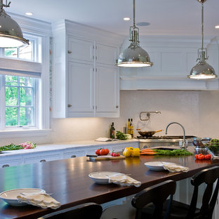 Inspiration for a timeless kitchen remodel in Boston with wood countertops
