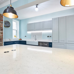 This is an example of a mid-sized l-shaped eat-in kitchen in Other with a farmhouse sink, shaker cabinets, blue cabinets, marble benchtops, white splashback, marble splashback, stainless steel appliances, porcelain floors, multiple islands, blue floor, white benchtop and coffered.