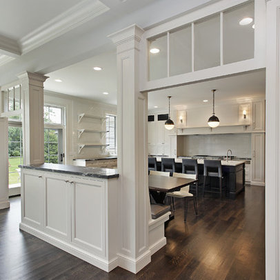 Pass through to custom white kitchen with built in banquette seating.