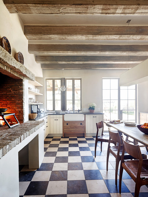 Inspiration for a rustic multicolored floor kitchen remodel in Phoenix with  a farmhouse sink