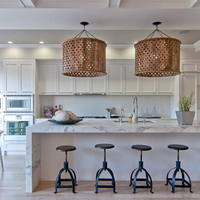 Inspiration for a transitional galley eat-in kitchen remodel in San Francisco with an undermount sink, recessed-panel cabinets, white cabinets and paneled appliances