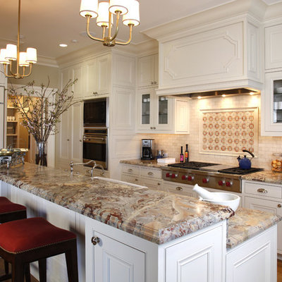Kitchen - traditional kitchen idea in San Francisco with beaded inset cabinets, white cabinets, multicolored backsplash and paneled appliances