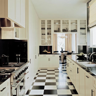 This is an example of an expansive victorian kitchen in San Francisco with white cabinets and multi-coloured floor.