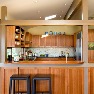 Design ideas for a midcentury u-shaped separate kitchen in Seattle with recessed-panel cabinets, medium wood cabinets, wood benchtops, mosaic tile splashback, stainless steel appliances and multi-coloured splashback.