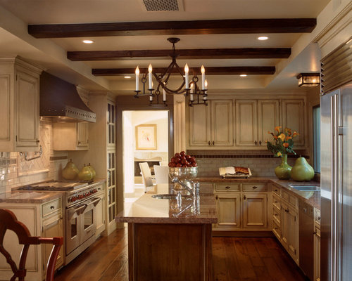 Example Of A Tuscan U Shaped Eat In Kitchen Design In Los Angeles With Part 19