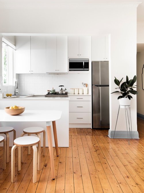 Small Contemporary Eat In Kitchen Inspiration   Small Trendy U Shaped  Medium Tone Wood