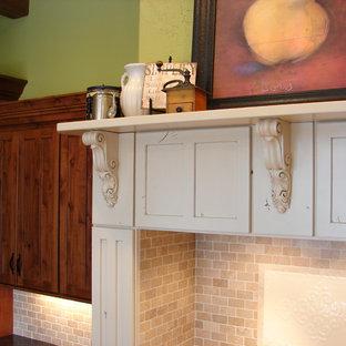 Example of a farmhouse u-shaped eat-in kitchen design in Denver with a farmhouse sink, flat-panel cabinets, beige cabinets, granite countertops, beige backsplash, stone tile backsplash and paneled appliances