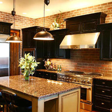 Contemporary Kitchen by Pahlisch Homes, Inc.