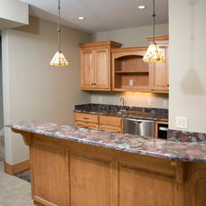 Traditional Basement by Riverstone, Inc