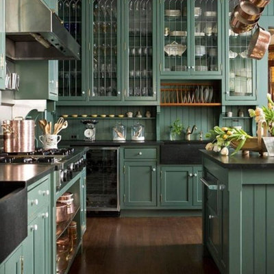 Eat-in kitchen - large traditional l-shaped dark wood floor and brown floor eat-in kitchen idea in Columbus with a farmhouse sink, recessed-panel cabinets, green cabinets, soapstone countertops, green backsplash, stainless steel appliances, an island and black countertops