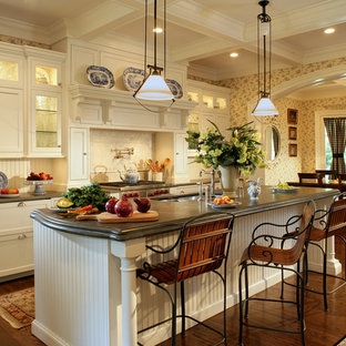 Mid-sized country galley eat-in kitchen in New York with an undermount sink, beaded inset cabinets, white cabinets, panelled appliances and medium hardwood floors.