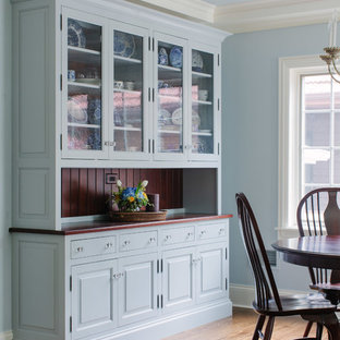 Painted gray blue dish storage in eating area