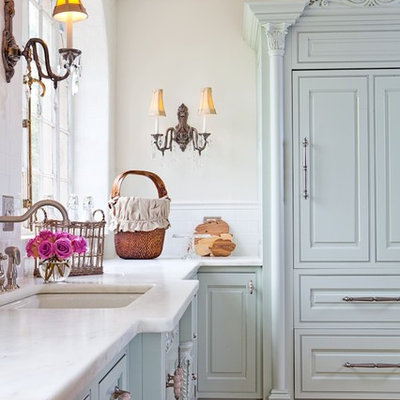 Inspiration for a mid-sized shabby-chic style u-shaped ceramic tile enclosed kitchen remodel in St Louis with an undermount sink, raised-panel cabinets, green cabinets, white backsplash, subway tile backsplash, paneled appliances and wood countertops