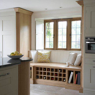 Design ideas for a large contemporary u-shaped kitchen/diner in West Midlands with a submerged sink, recessed-panel cabinets, grey cabinets, granite worktops, stainless steel appliances, ceramic flooring and an island.