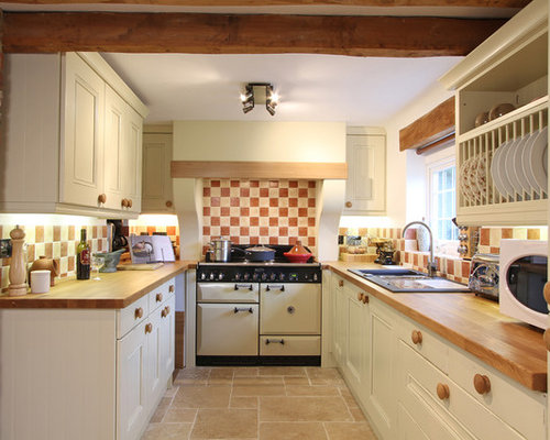 Beau Example Of A Mountain Style Enclosed Kitchen Design In Hampshire With Wood  Countertops, White Appliances