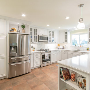 Mid-sized shabby-chic style eat-in kitchen designs - Eat-in kitchen - mid-sized shabby-chic style u-shaped porcelain tile eat-in kitchen idea in Orange County with an undermount sink, raised-panel cabinets, white cabinets, quartz countertops, white backsplash, ceramic backsplash and stainless steel appliances