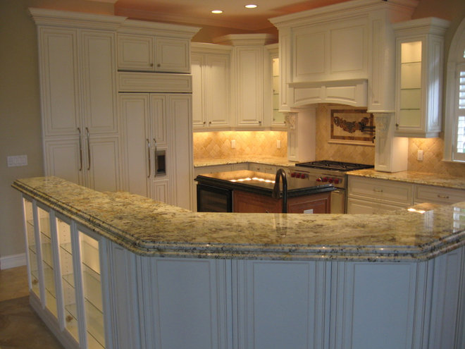 Traditional Kitchen by Cornerstone Builders of SWFL