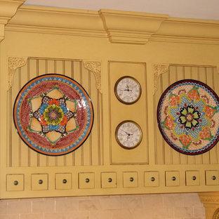 Idéer för att renovera ett mycket stort vintage kök och matrum, med en köksö, gula skåp, granitbänkskiva, gult stänkskydd, stänkskydd i tunnelbanekakel, vita vitvaror, en rustik diskho och klinkergolv i terrakotta
