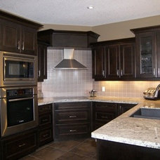 Traditional Kitchen by Quality Construction Services