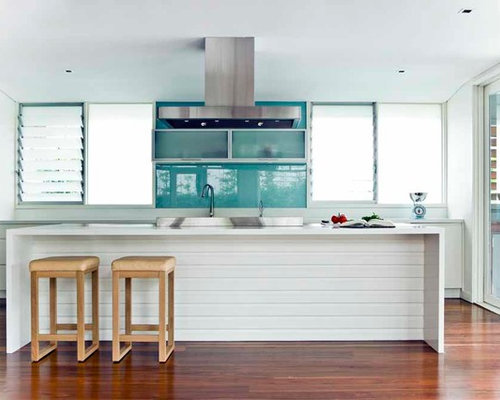 simple kitchen designs. example of a coastal galley medium tone wood floor kitchen design in sydney with white cabinets simple designs m