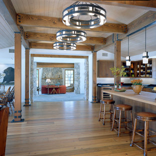 Rustic open concept kitchen remodeling - Inspiration for a rustic open concept kitchen remodel in Los Angeles with open cabinets and medium tone wood cabinets