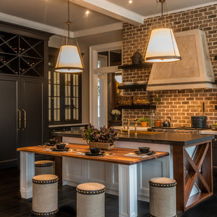 Elegant dark wood floor eat-in kitchen photo in Other with open cabinets, paneled appliances, an island and a farmhouse sink