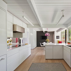 The original kitchen was reconfigured allowing for a large dining area suitable for childrenu0027s projects as well. & Eichler Lighting | Houzz azcodes.com