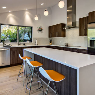 Example of a mid-sized 1960s l-shaped light wood floor and brown floor eat-in kitchen design in San Francisco with an undermount sink, flat-panel cabinets, dark wood cabinets, quartz countertops, gray backsplash, glass tile backsplash, stainless steel appliances, an island and white countertops