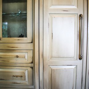 Design ideas for a medium sized rustic u-shaped open plan kitchen in Miami with a built-in sink, raised-panel cabinets, distressed cabinets, marble worktops, beige splashback, mosaic tiled splashback, stainless steel appliances, plywood flooring, no island, brown floors and multicoloured worktops.
