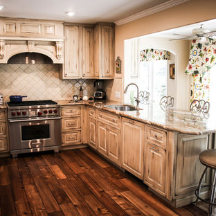 This is an example of a medium sized rustic u-shaped open plan kitchen in Miami with a built-in sink, raised-panel cabinets, distressed cabinets, marble worktops, beige splashback, mosaic tiled splashback, stainless steel appliances, plywood flooring, no island, brown floors and multicoloured worktops.