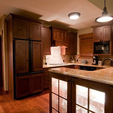 Rustic Kitchen by Somrak Concept and Structure, Inc.