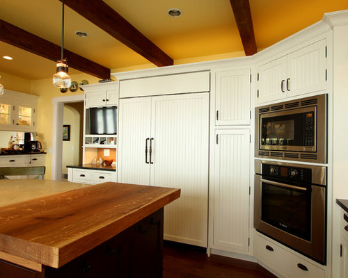 White Inset Cabinets with Beadboard Center Panels and Dark Stained Maple Island