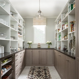 Large modern u-shaped kitchen pantry in Other with shaker cabinets, brown cabinets, granite benchtops, porcelain floors and blue benchtop.
