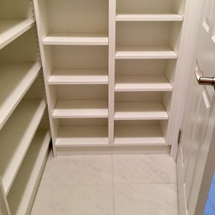 Minimalist kitchen pantry photo in Orange County with open cabinets and white cabinets