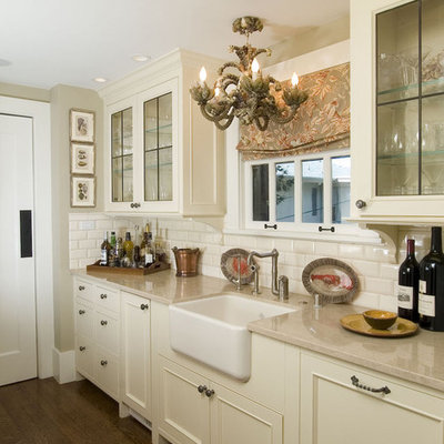 Kitchen - traditional kitchen idea in San Francisco with beaded inset cabinets, a farmhouse sink, beige cabinets, white backsplash and subway tile backsplash